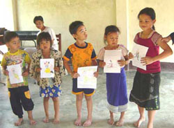 Lao kids holding their art contest entries