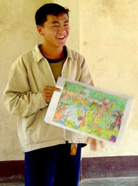 A Lao boy holding his art contest winning entry