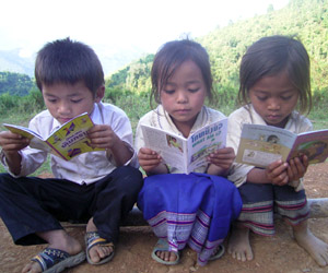 Children at a rural book party as they discover the fun of reading
