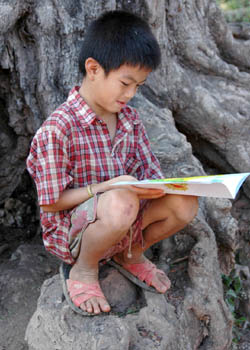 A boy in a rural Lao village discovers the fun of reading