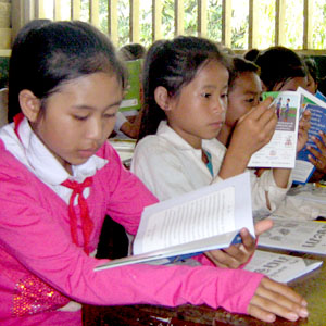 Children at a rural book party in Laos