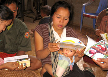 A home-based library in Laos. This woman is looking at