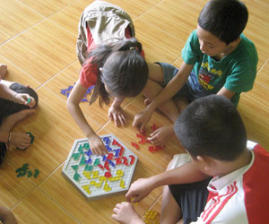 Big Sister Mouse students learn from games and toys